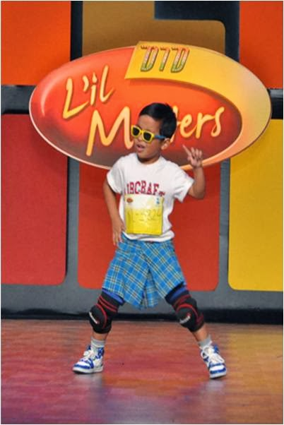A kid performing Lungi dance on the stage of DID Little Master Season 3