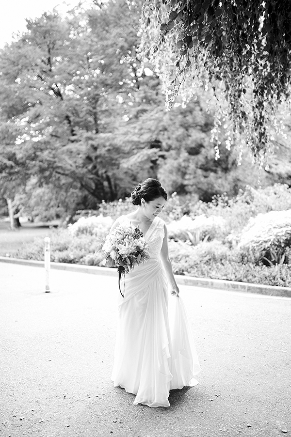 Vancouver-based beauty, life and style blogger in a David's Bridal wedding gown in Stanley Park, Vancouver, Canada; bridal bouquet by Flower Factory