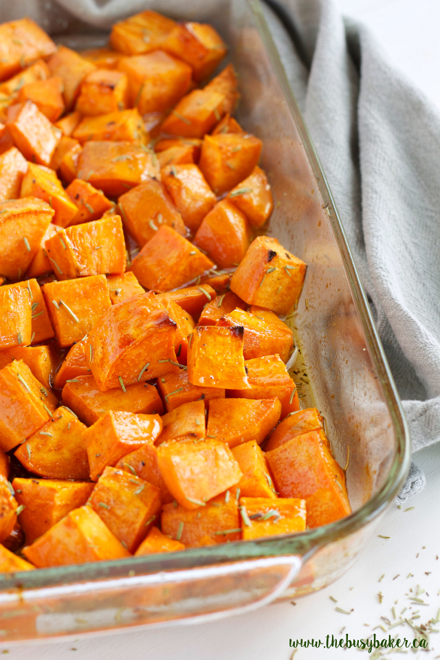 These Maple Rosemary Roasted Sweet Potatoes are the perfect holiday side dish! Recipe from www.thebusybaker.ca!