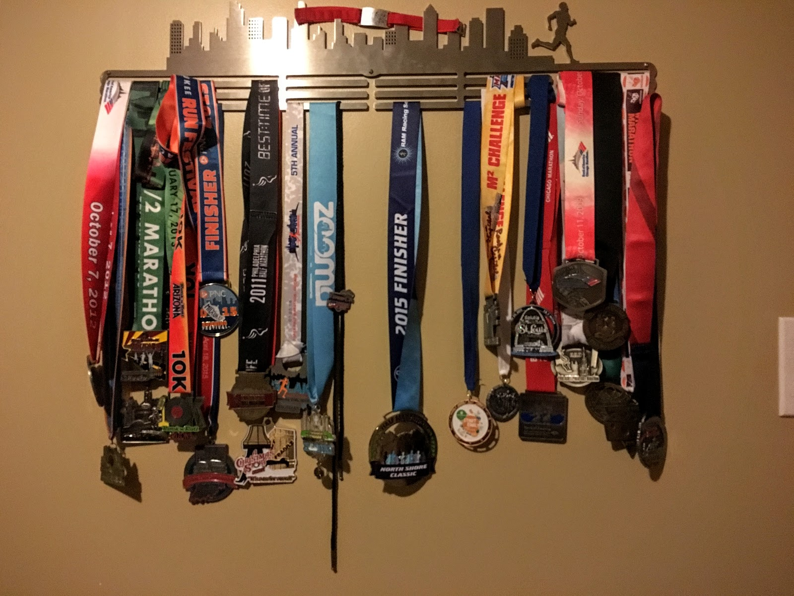 the race uk photo gymnastics fascinating running shelf on trophy hayneses with hanger metal sports holder and cu terrific medal