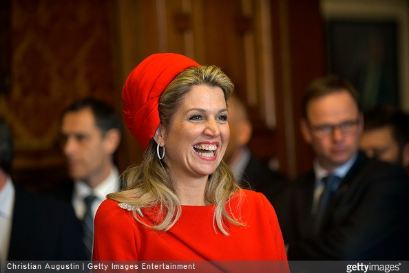 Queen Maxima of The Netherlands laughs during a short statement of King Willem-Alexander of The Netherlands at the townhall of Hamburg on March 20, 2015 in Hamburg, Germany