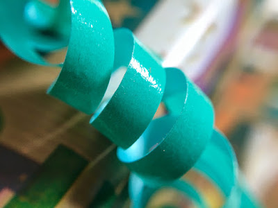 Curled gift wrap ribbon