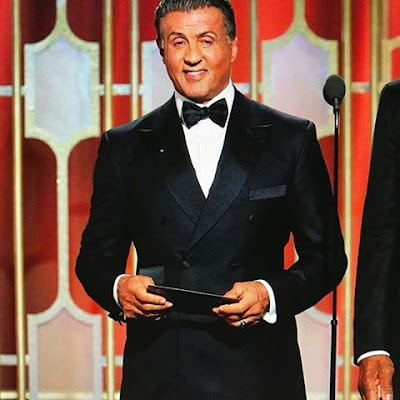 Sylvester Stallone APPRECIATES his tailor for his suit.