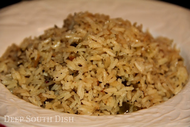 Rice and a Trinity of veggies are first sauteed in butter, then simmered in chicken stock for a wonderful rice side dish that is just as good for pork, as it is for chicken, shrimp, fish, or beef.