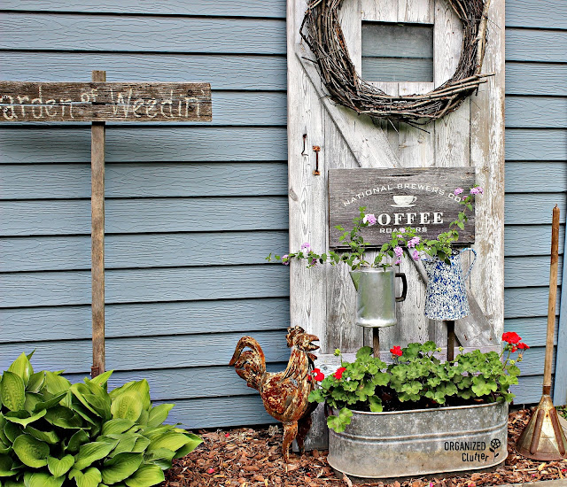 Coffee Themed Junk Garden Vignette with Barn Door Backdrop organizedclutter.net
