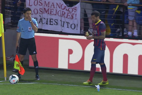 Barcelona player Daniel Alves is seen peeling off a banana which was thrown at him