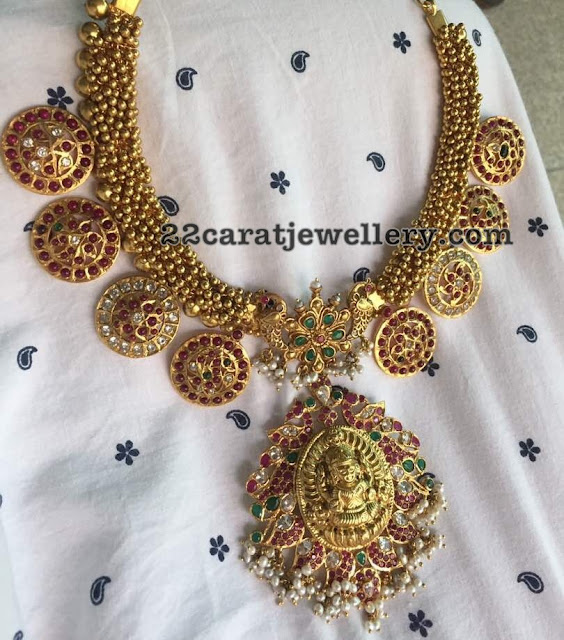 Silver Necklace with Swirls and Lakshmi Pendant