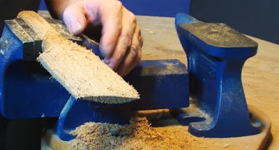 "Carving a spatula from a blockof cedar in a Recoed 4"" vise"