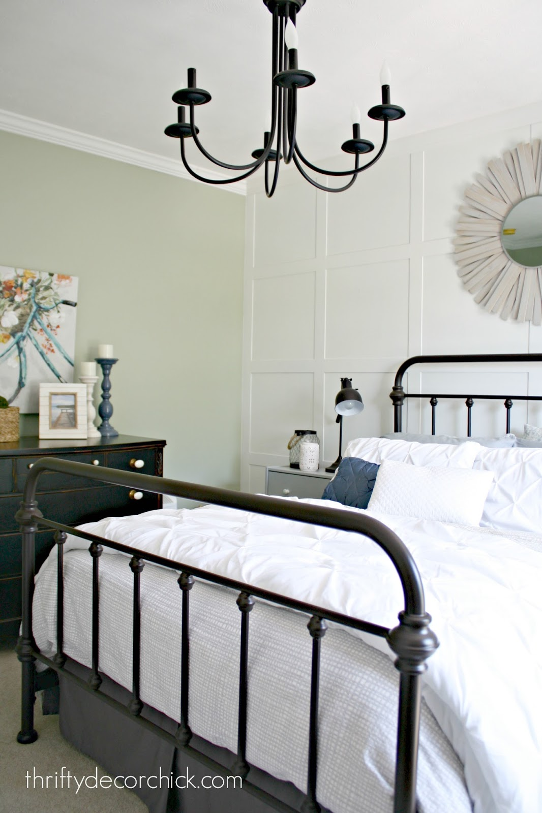Elegant White accent wall with molding in bedroom