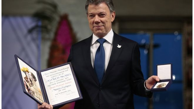 Colombia's Santos accepts Nobel Prize as 'gift from heaven'