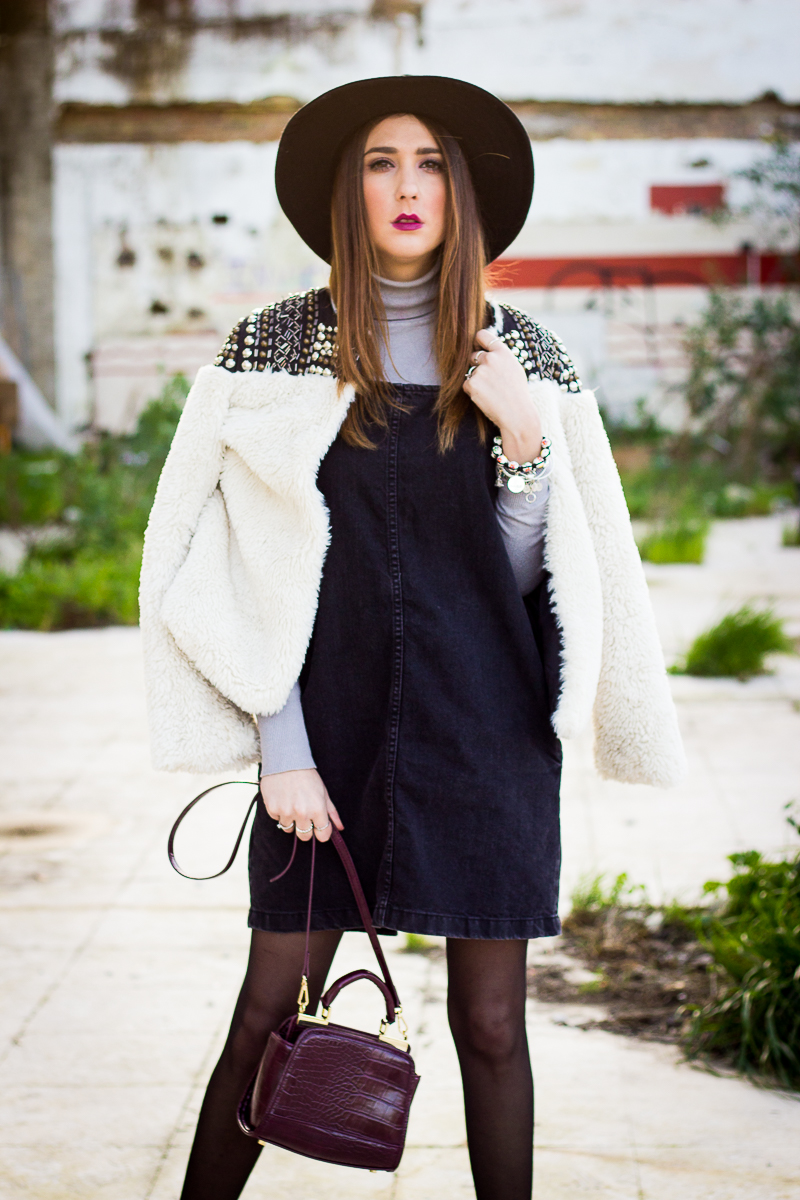 fur coat and denim overall