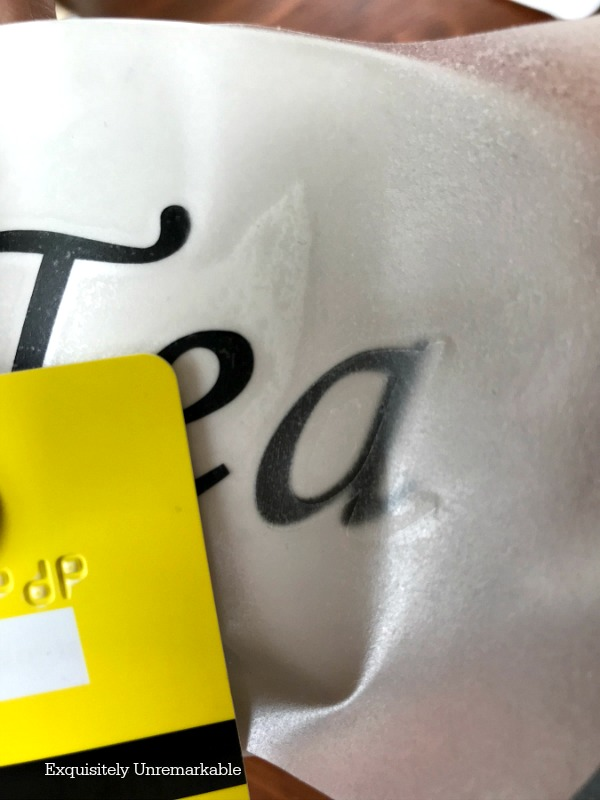 Applying A Vinyl Transfer On A Tea Cup with a credit card