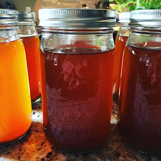 Photo of home canned vegetable stock. https://trimazing.com/