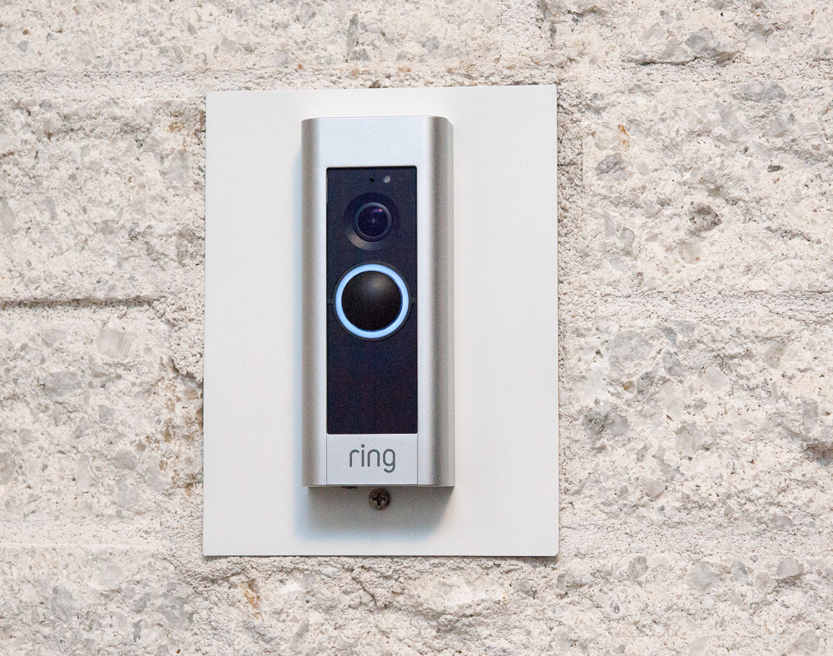 hight resolution of ring pro intalled and configured with the solid white light around the doorbell button glowing and the silver trim plate installed