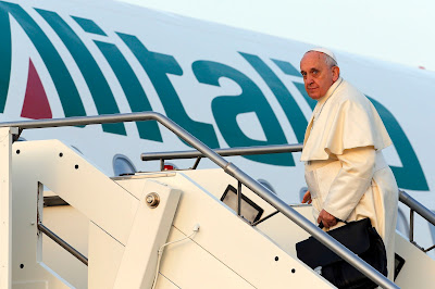 Pope Francis entering aeroplane