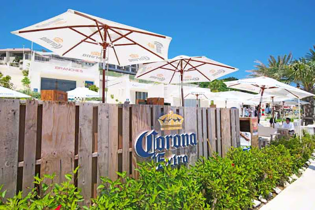 sun umbrellas, fence, Corona Beer, sign