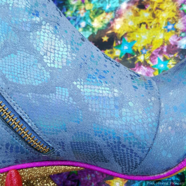 close up of blue rainbow snakeskin material on upper of boot