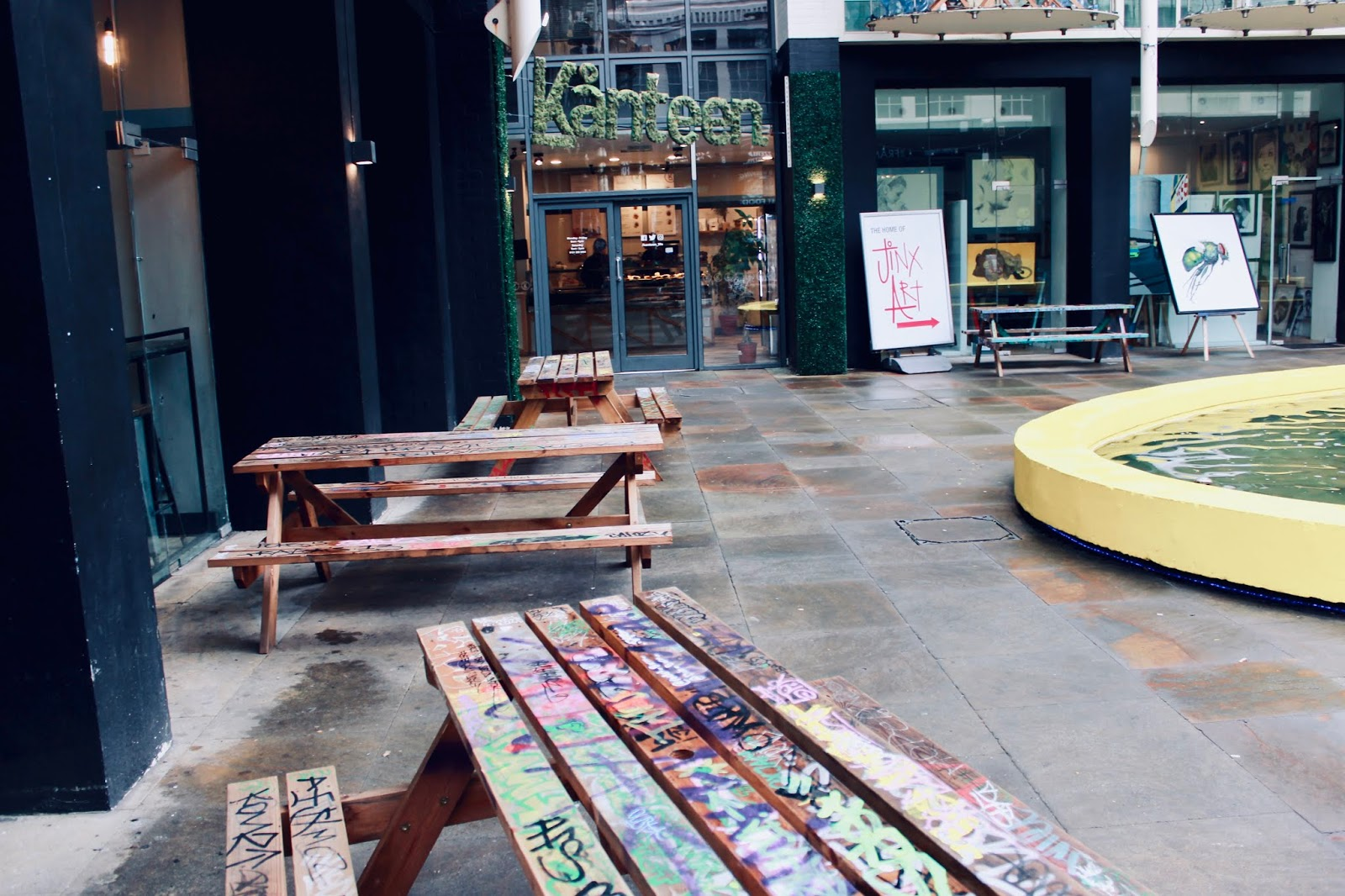 An image of some benches with graffiti on