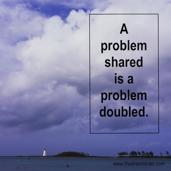 Inspirational picture quote with lighthouse: 'A problem shared...'