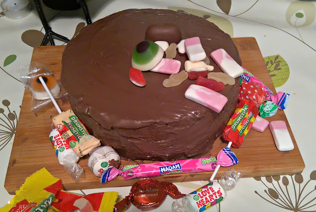 chocolate cake covered in sweets