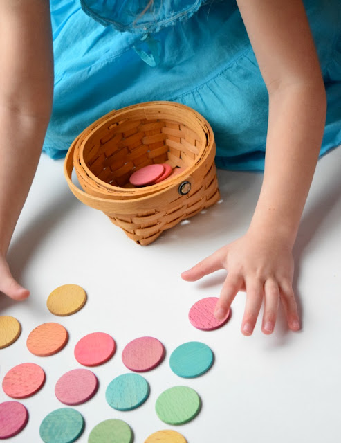 Dyed colored wooden discs for learning or playing