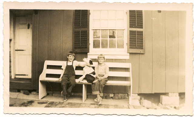 "A boy, a girl, and a spotted dog, all sitting on a bench. Reverse reads ""Richard, ""Tippie,"" Cathy. Unidentified"