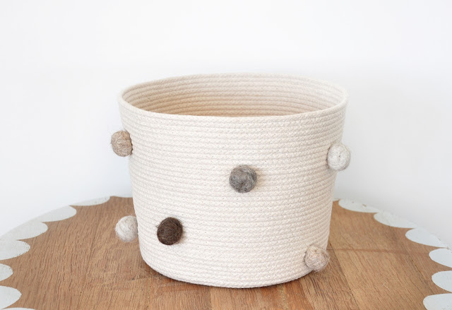 Coiled rope basket pom poms