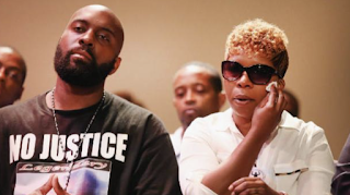 Why did Ferguson pay Michael Brown's family $1.5 million?