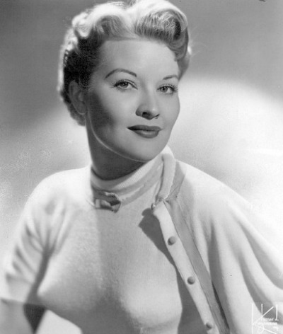 Patti Page posed in sweater twin set accentuating her bosom wearing a bullet bra