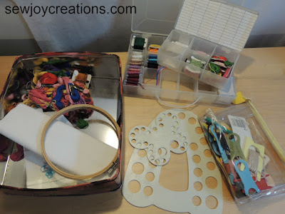 tin of embroidery floss and yarn crafts