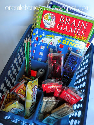 Road trip basket for kids - books, games and snacks