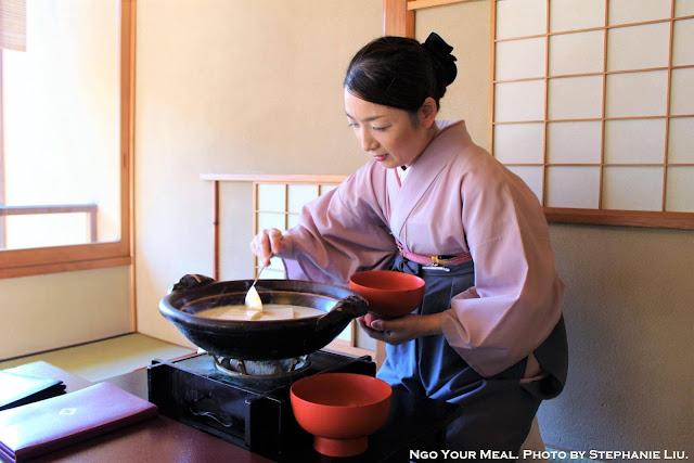 Waitress serving Tofu at Tokyo Shiba Tofuya Ukai in Tokyo, Japan