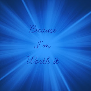 "navy text on blue background reading ""because I'm worth it"""