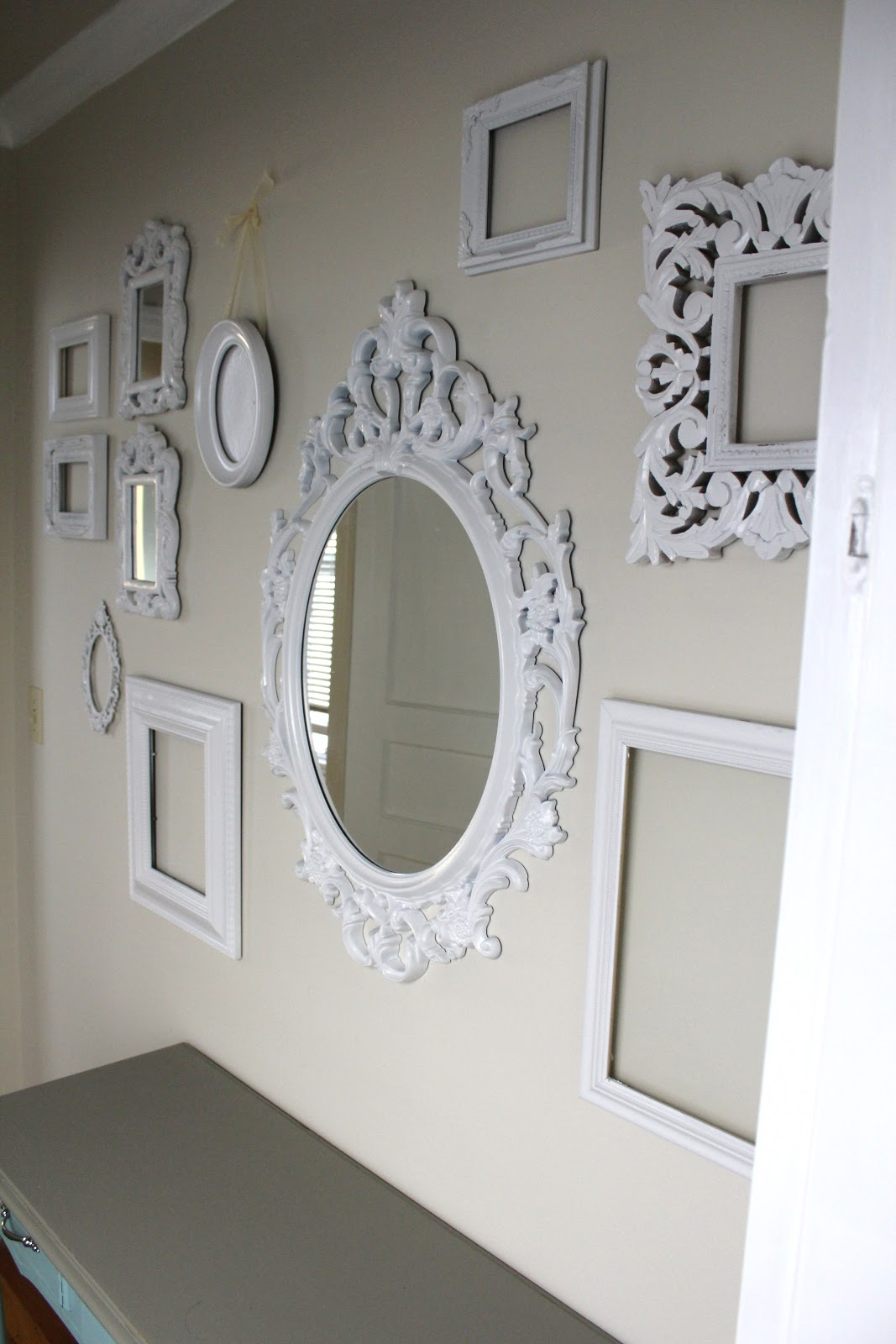 Cup Half Full Gallery Wall Of White Ornate Frames