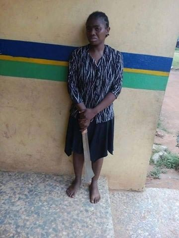 Wife who butchered man in Ogun poses with object of mass decimation