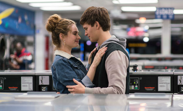 Baby (Ansel Elgort) and Debora (Lily James) gets romantic in BABY DRIVER (2017)