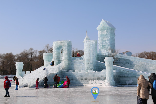 Sliding activity on the ice sculpture at Harbin Snow Sculpture Art Expo in Heilongjiang province, China