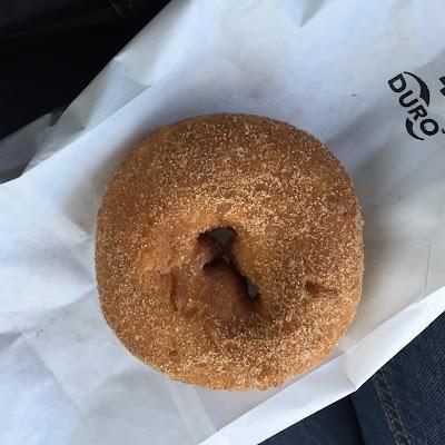Freshly baked apple cider donut from Apple Hut in Beloit, Wisconsin.