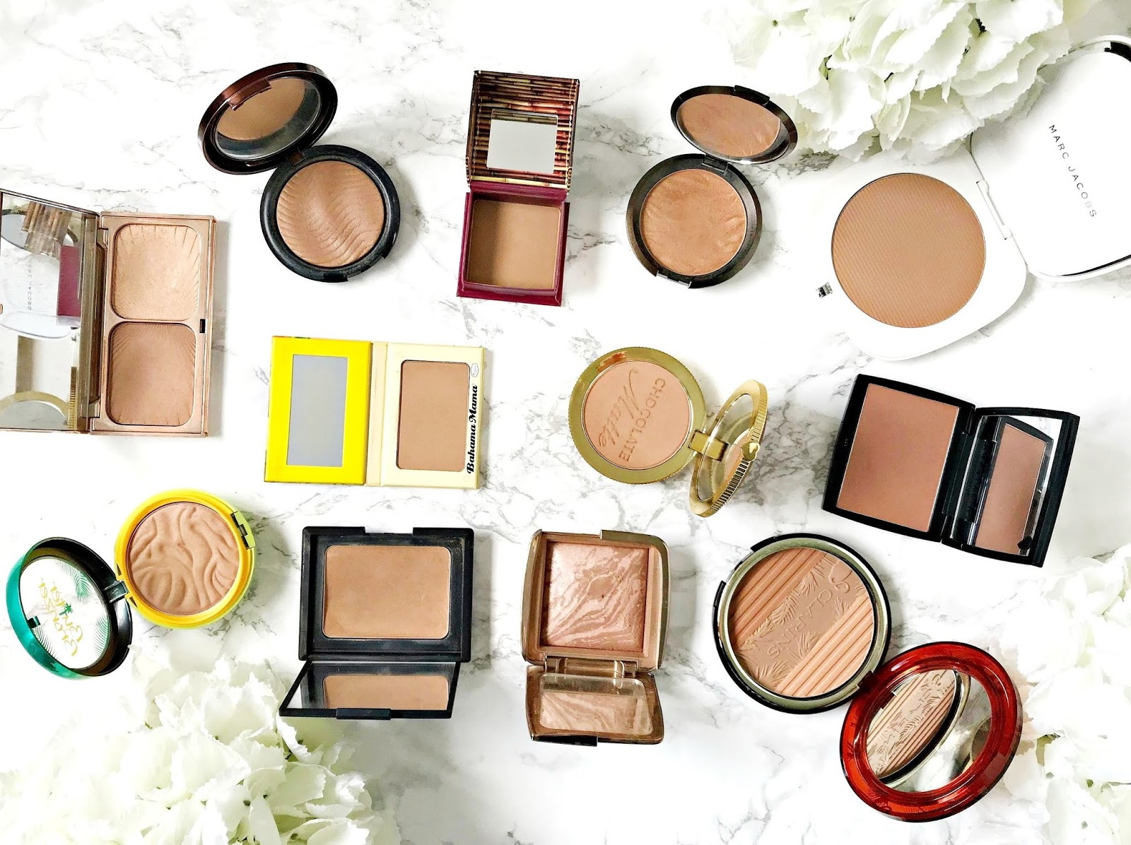 The Bronzer Edit: Bronzer, Nars Laguna, Benefit Hoola, Make Up For Ever Pro Bronze Fusion, Becca Sunlit Bronzer, Marc Jacobs O'Mega Bronzer, Anastasia Beverly Hills Tawny Bronzer, Too Faced Chocolate Soleil, theBalm Bahama Mama, Charlotte Tilbury Filmstar Bronze & Glow,
