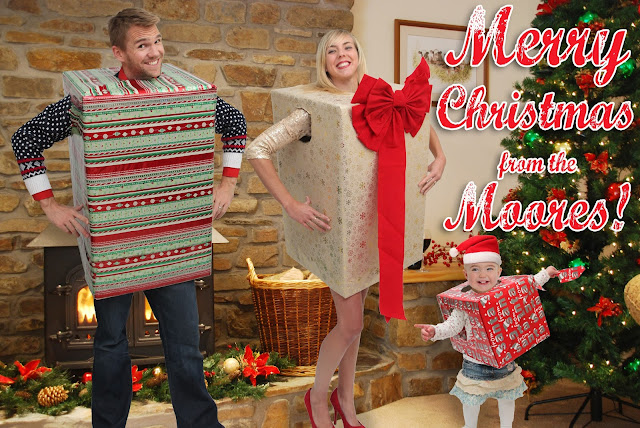 The Moores Cheesy Christmas Family Photo with toddler