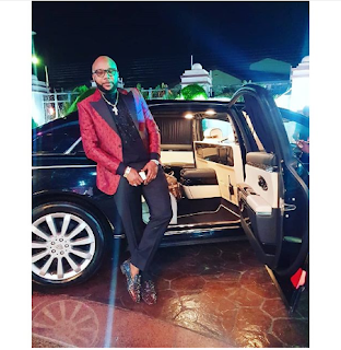 E MONEY LOOKS DAPPER, SHOWS OFF HIS MAYBACH
