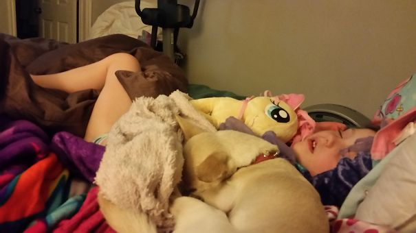 15+ Hilarious Pics That Prove Kids Can Sleep Anywhere - Napping With The Dog
