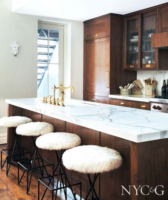 walnut kitchen with marble countertops