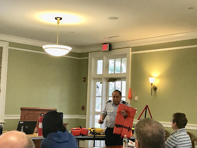 Bill Castagno shows the importance of a lifejacket.