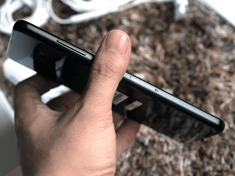 Volume rocker and sim card tray