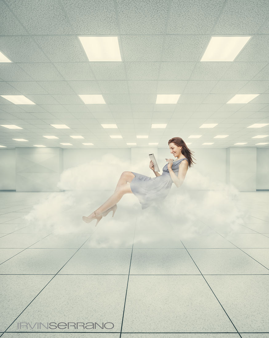 A young woman holding ipad floating on a cloud, representing the concept of the digital cloud and data storage.