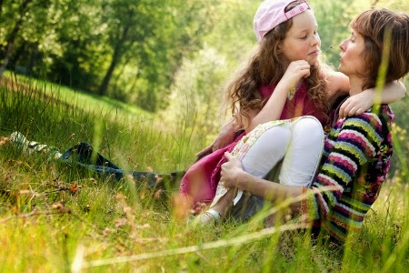 NAMC montessori positive time outs girl and mother sitting in grass