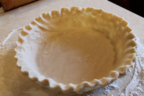 A pie dough ready for baking.