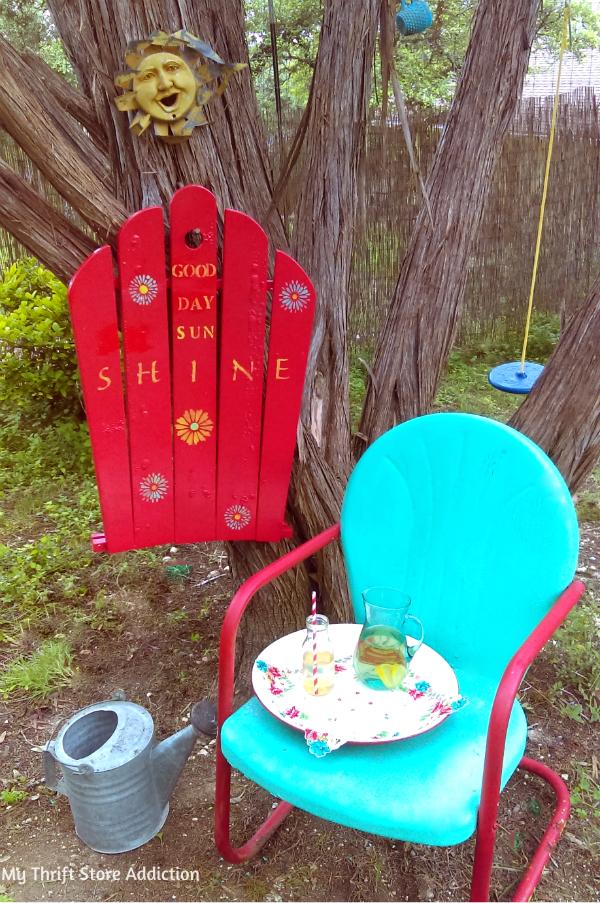 Repurposed broken chair garden sign