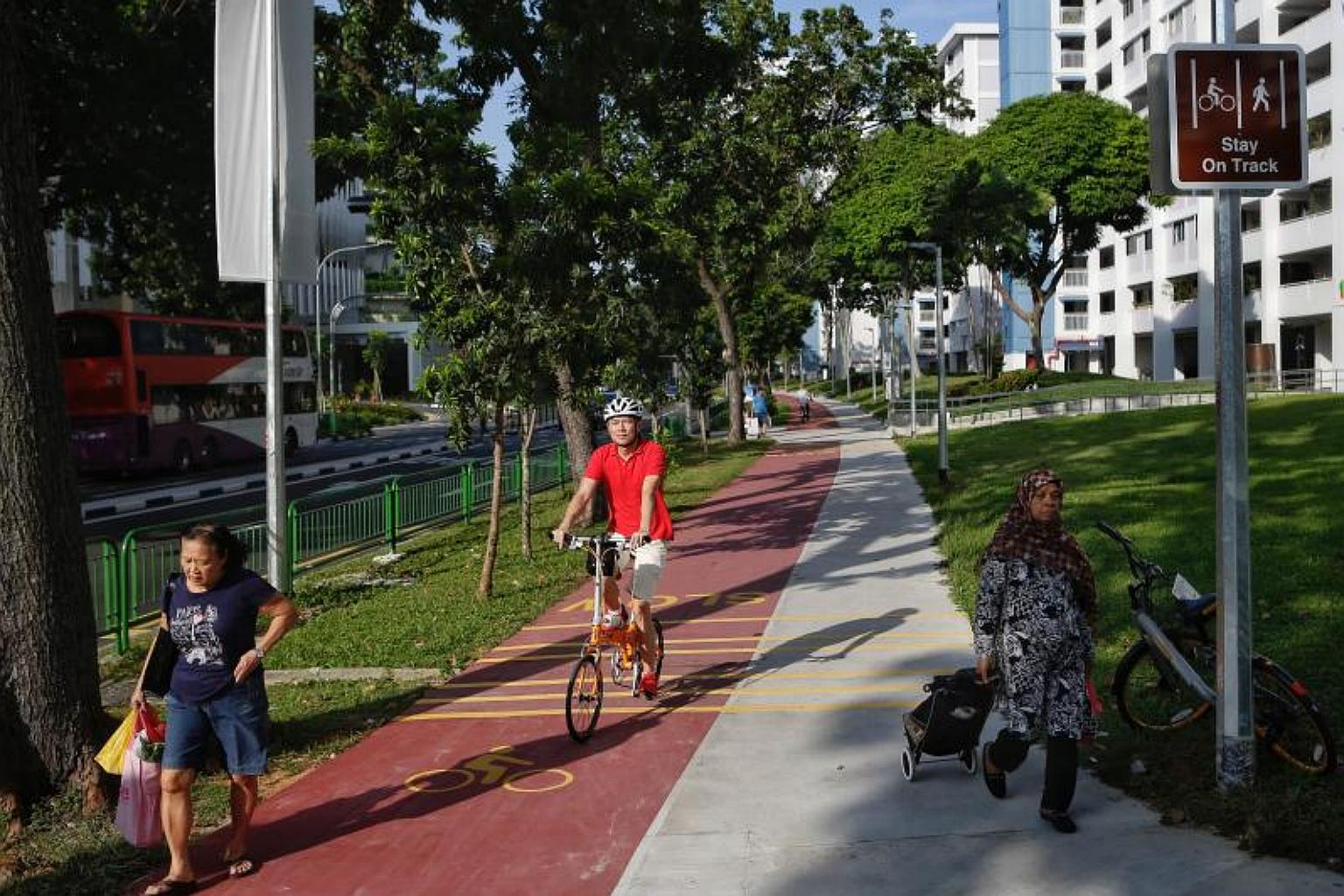 A cyclist using the red path along Bedok North Street 1 on 21 December 2017.